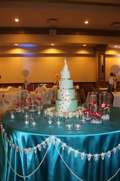 Gorgeous peacock cake. Cake table by INDS decor