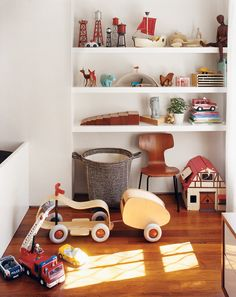 The furniture-such as a Noguchi side table-is pushed to the side to create ample floor space for play. // from a well-designed life on domino