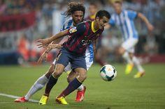Pedro pugna con Sergio Sánchez. | Málaga 0-1 FC Barcelona. [25.08.13]
