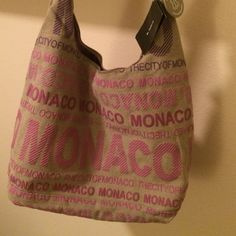 Robin Ruth Monaco Bag High quality Robin Ruth City Bag, for a gift or a souvenir of Monaco. Brand: Robin Ruth. Pattern: Inscriptions Monaco. Material: 100% canvas. Dimensions: 48cm x 37cm (18.9in x 14.6in). Zip and internal pocket with zip. Robin Ruth original certified item. Robin Ruth Bags