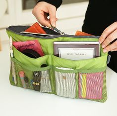 """Slim Purse Organizer.  These are so cool because providing your purses are all of similar shape and size you just whip it out of one purse and right into the next one that matches todays outfit.  If you sew there are many patterns out there to make one or two of them. I will find and pin a couple under """"For the Sewing Room""""."""