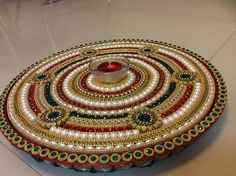 big diya thali Cd Crafts, Craft Stick Crafts, Hobbies And Crafts, Diy Craft Projects, Craft Sticks, Rangoli Designs Flower, Flower Rangoli, Thali Decoration Ideas, Diwali Decorations