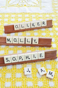 """Spell names using Scrabble pieces and arrange on wooded stands to make place names for your top-table guests."" Styling: Polly Atkinson. Photo: Nato Welton. Brides Magazine UK (July/August 2009)."