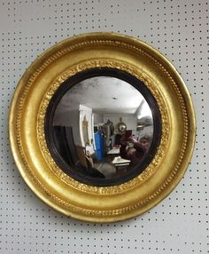 A wonderful antique convex mirror.