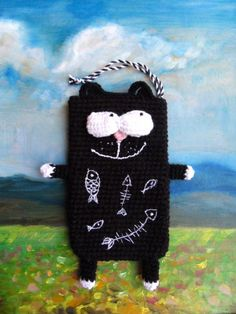 Knitted cover for a mobile phone - cute cat who dreams of fish.