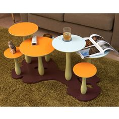 """""""The Mushroom Forest series features several caps which function as flat table tops, each with different heights and cap size. The sturdy base provides an extremely stable platform for the multiple mushroom table tops. The Mushroom Forest Series of tables will surely up the level of fun and style to any room of the house."""""""