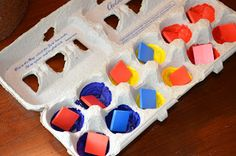 Paint the egg carton different colors and use fruit loops or life savers, or foam pieces to match the color