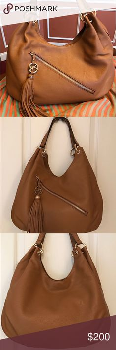 MICHAEL KORS CHARM TASSEL SHOULDER BAG Authentic Micheal KORS Charm Tassel Large Shoulder Bag is a perfect everyday carry. Beautiful luggage brown with soft leather exterior, signature satin interior,  magnetic snap close-1 interior zip & 4 additional pockets with hanging tassel pendant. Bag is new without tags, never used/clean & smoke free household. Michael Kors Bags Shoulder Bags