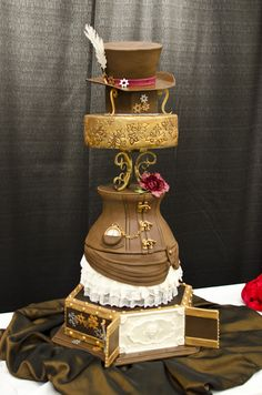 My cake from the That Takes the Cake competition in Austin, TX 2014. my cake won 1st place in my division!  Steampunk cake with corset and bustle. sugarveil, fondant, wafer paper, isomalt www.unameitcs.com