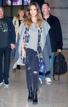 Jessica Alba in a cozy laid back outfit with flannel shirt, and ripped skinny jeans.