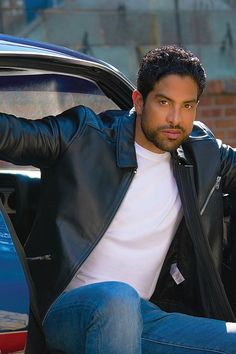 Adam Rodriguez steps out of a bright blue sports car in style. He rocks the greaser hairstyle paired with the classic black leather jacket, white tee and jeans. This classic men's style is timeless and sexy. Beautiful Men Faces, Gorgeous Men, Beautiful People, Les Experts Miami, Hot Mexican Men, Michael Rodriguez, Criminal Minds Cast, Actors Male, Designer Suits For Men
