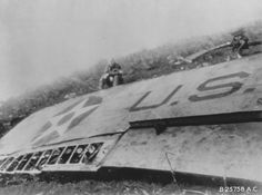 James Doolittle sitting by the wing of his wrecked B-25 Mitchell bomber China 18 April 1942.