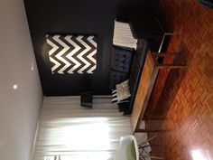My favourite Corner: Florence Knoll Leather Couch, Eames Chair, Chevron pattern painted canvas...