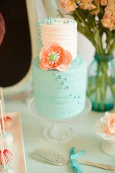 Peach and teal wedding cake
