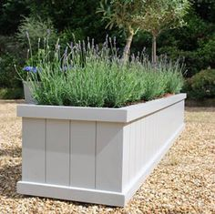 The Flauden Planter is one of our most popular designs. Handmade from exterior hard wood and hand painted in three coats of exterior paint with a Farrow and Ball colour of your choice (Elephant's Breath, Down Pipe, Vert de Terre, Lamp Room Gray). The Flaunden Planter seen here is painted in 'Lamp Room Gray'