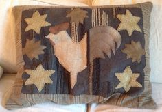 This rooster pillow is my own design taken from an old hooked rug.