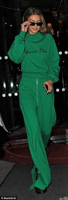 Casual: Gigi was later seen leaving her hotel in an emerald green tracksuit