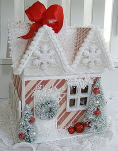 Gingerbread house box filled with ornaments.