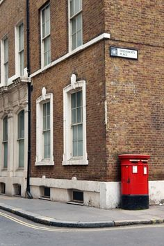 Classic red postbox in East London