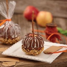 These spectacular DIY dipped apples are a combination of Wilton® Caramel Dip and nuts with Wilton Light Cocoa and White Candy Melts® Candy.