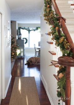 Gorgeous Christmas Home Tour by Just a Girl. Love the fluffy garland in neutral tones.