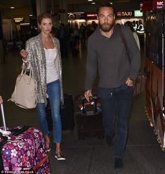 Good to be home? Donna Air and James Middleton were spotted arriving in London on Tuesday ...