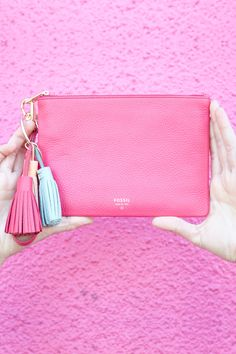 For the girl who loves color, the pomegranate wristlet clutch and tassel charm are just for you.