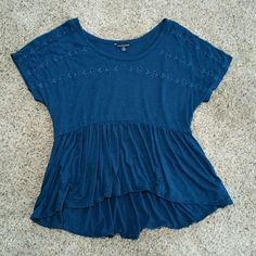 American Eagle Peplum blouse American Eagle Peplum blouse that is a high-low cut. Unique blue color and has a leaf pattern stitched across the front of the shirt. Never worn and in perfect condition. No trades. American Eagle Outfitters Tops