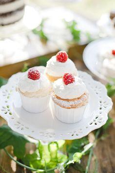 Raspberry topped cupcakes   Photography: Eliza & Elizabeth - elizaandelizabeth.com  Read More: http://www.stylemepretty.com/little-black-book-blog/2014/05/08/dreamy-poem-wedding-inspiration/