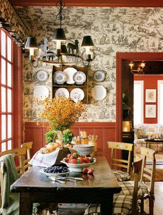 french style interior This breakfast room has a charming black and white toile mixed with red paneling.