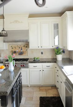 Blue pearl granite countertops bring luxury and beauty to for Adding knobs to kitchen cabinets