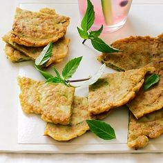 Zucchini and Thai Basil Pancakes by Sunset Magazine. This savory appetizer recipe for Zucchini and Thai Basil Pancakes is a bit like latkes--moist inside and crispy at the edges.