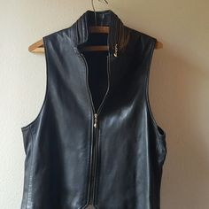 NWOT fabulous DKNY leather vest This Donna Karen 100% leather vest is gorgeous it is a little bit slim saying, has very sturdy zipper and a very unique detailing of the zipper around the collar making it so unique I've never seen another one like it. This is a truly fabulous piece that would complete any wardrobe as a coordinating piece. It has a black satin interior and there are no flaws whatsoever on the vest. I wish it were my size! DKNY Jackets & Coats Vests