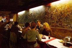 Le Refuge des Fondues Paris. Quirky little restaurant that serves its booze in babies bottles