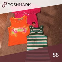 3-piece once gently used girls' 7/8 shirts The orange tank top has sparkles not visible in the image. The Dora the Explorer shirt has a bilingual caption. The striped tank top is ribbed. Get $2 off if you bundle. Can't be combined with other offers. Bundle 3 and get two more dollars off. Shirts & Tops