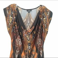 Dress Pull over 95% polyester 5%spandex dress multi colored Browns Black and Tan and grey pattern.  Scoop cowl type neck with small cap sleeves. Stretchy very comfortable fabric never worn. Snap Dresses Midi