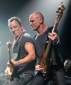 One of my favorite photos! #Sting and #BruceSpringsteen perform together at Sting's Birthday Concert October 1, 2011, for more on concert http://stingfield.com/blog/2011/10/02/happy-birthday-sting-beacon-theatre-new-york-october-1-2011/