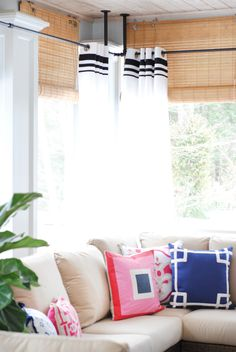 Airy and polished screened porch makeover with outdoor curtains, an electric fireplace, seating and dining areas, navy blue and pink accents. Corner Curtain Rod, Corner Curtains, Curtain Rods, Sunroom Curtains, Hanging Curtains, Shower Curtains, Porch Makeover, Outdoor Curtains, Custom Curtains
