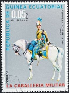 REPUBLIC OF EQUATORIAL GUINEA Guinea - CIRCA 1976: A postage stamp printed in the Equatorial Guinea shows army uniform of military cavalry - spain hussar in 1833 year , circa 1976 photo