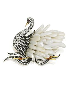 Gold, Silver, Freshwater Pearl and Diamond Swan Brooch. With numerous freshwater pearl feathers, the swan enhanced by old mine, old European and single-cut diamonds weighing approximately 7.40 carats, accented with a ruby eye and enameled reeds.