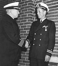 John F. Kennedy receives the Navy and Marine Corps Medal for his courage in the PT-109 incident. Description from lisawallerrogers.wordpress.com. I searched for this on bing.com/images