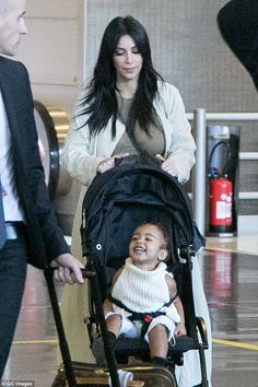 Happy girl: North wore a cute white knitted top with denim shorts and boots...