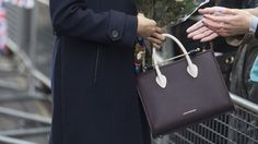 Prince Harry's future wife carried a £455 Strathberry tri-colour leather midi tote (Jeremy Selwyn/Evening Standard/PA)