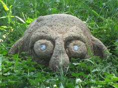 """Grots are night creatures that live in the dark corners of your garden and are rarely seen or heard. this is a large, solid hypertufa garden grot (10"""" across, 6"""" high)."""