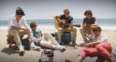 Even One Direction is staying SunSmart on the beach!