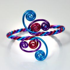 This bracelet is made out of three 12 gauge anodized aluminum wires in shiny colorful wire. I made and designed this piece to be adjustable and