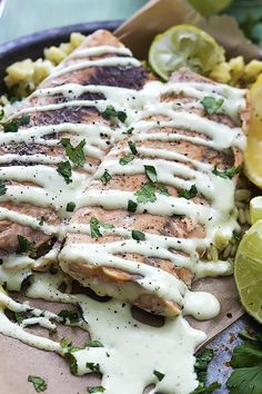 Baked Salmon with Creamy Avocado Sauce - tender pink salmon baked in foil, then drizzled with zesty and creamy avocado sauce. An easy and healthy recipe!