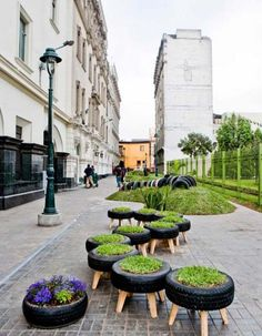 Here's a super smart idea for recycling tyres. Turn them into lawn seats. This park in the historic town of Lima, Peru incorporates tyre planters, tyre seats and a children's playground made up of recycled plastic and tyres. How clever is that?!    More images from Architizer.