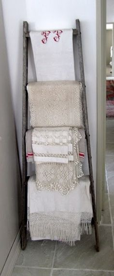old ladder with linens