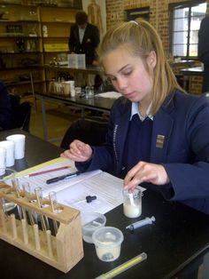 Testing the rate of cellular respiration in yeast during her Biology practical pre-lim exam.